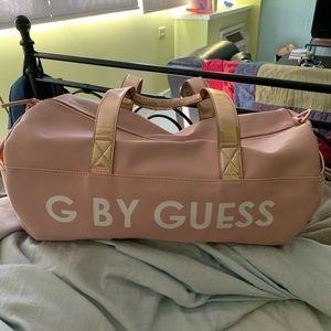 Women s Guess Duffle Bag on Poshmark 5eab6156acc85